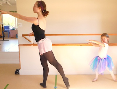 Teacher and student at the barre demonstrating tundu